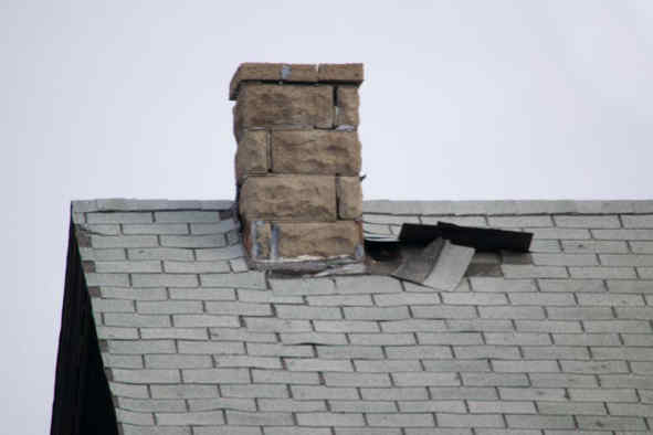 Roof damage around a chimney
