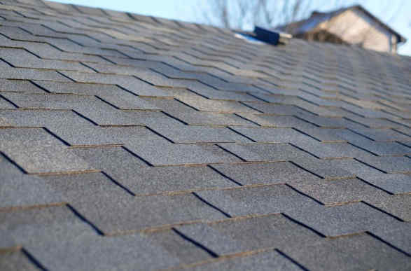 Newly installed asphalt shingles on a roof.