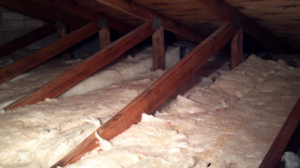 White attic insulation between rafters