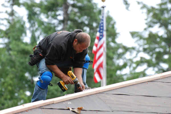 Roofing contractor working on a roof.