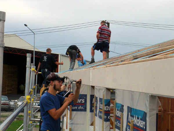Roofers installing new fascia board