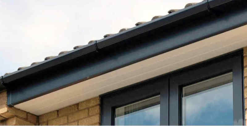 Black fascia on a house with a metal roof