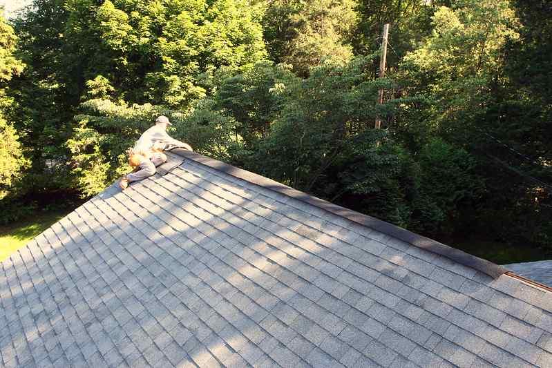Roofer installing a roof ridge