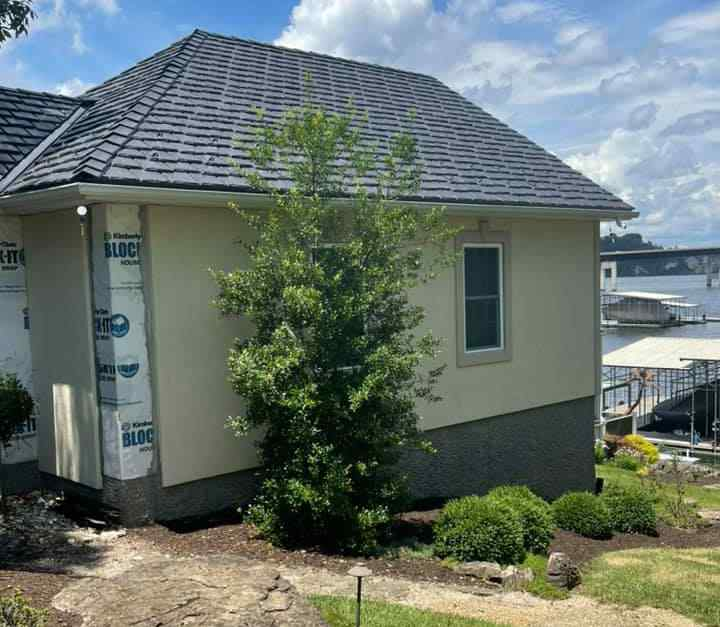 New style of composite shingles installed on a Lake Ozark, MO home with Lake of the Ozarks in the background