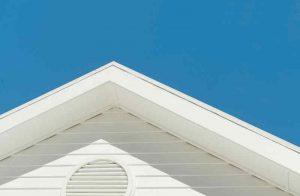 Nice new fascia board on a white house against a blue sky in Lake Ozark, MO