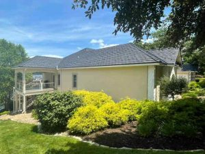 New black composite roof shingles on an attractive Lake of the Ozarks home with landscaping