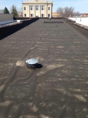 This is an old tar roof we worked on, before our Seamless Foam Installation.